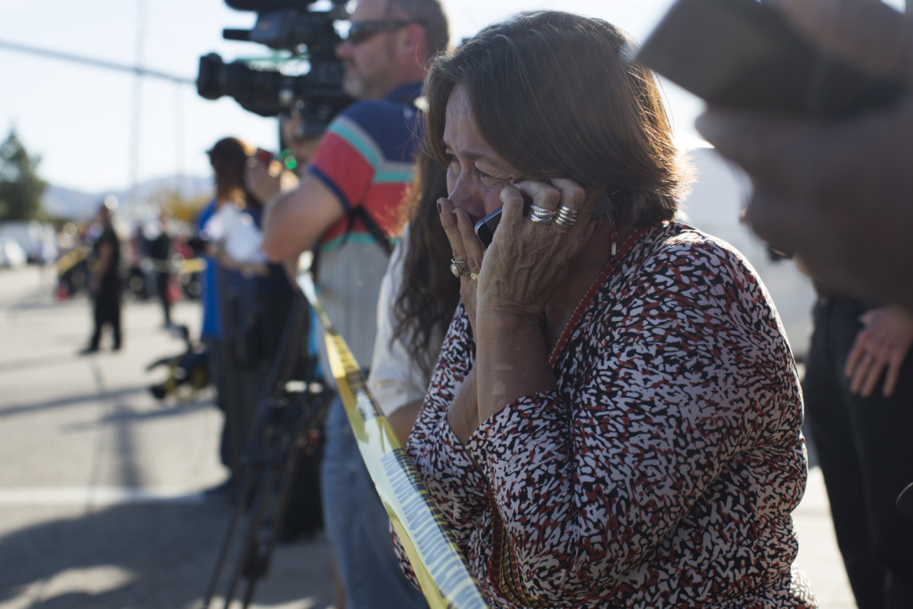 Olivia Navarro, 63, waits to hear the status of her daughter, Jamil Navarro, who works in the Inland Regional Center in San Bernardino where a mass shooting took place on Wednesday, Dec. 2, 2015.