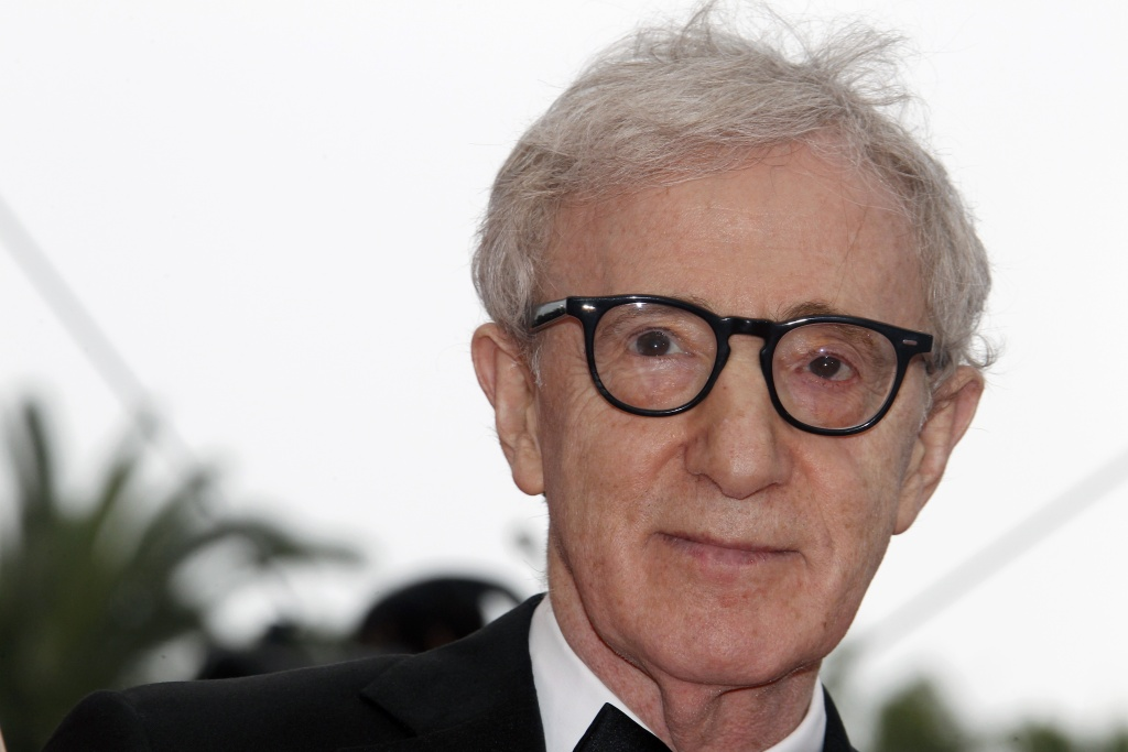 Director Woody Allen poses on the red carpet before the opening ceremony and the screening of