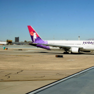 A Hawaiian Airlines jet taxies out to th