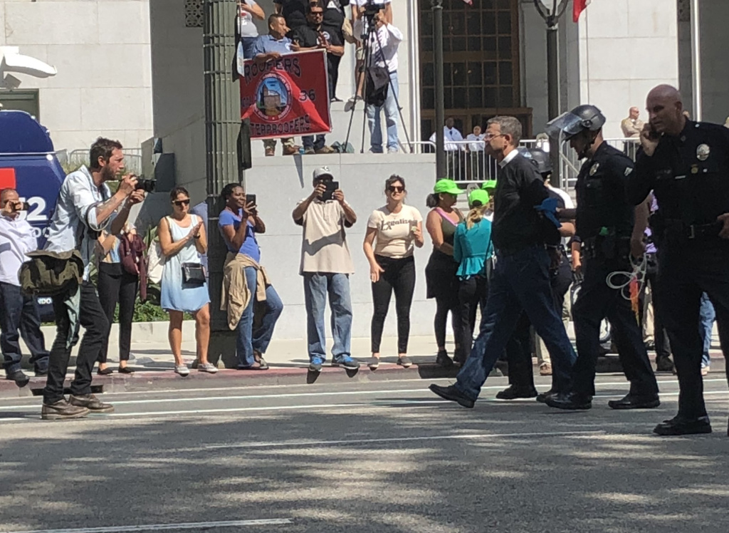 Protesters in downtown L.A. on Tuesday were arrested after refusing to move from the street.