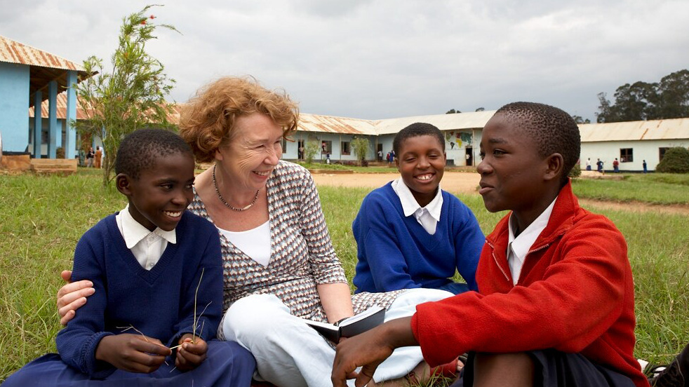 Ann Cotton, pictured with students in Tanzania, makes sure girls have the funds for everything from books to shoes, so they won't