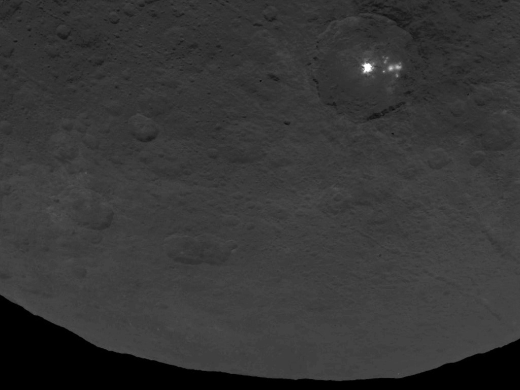 NASA flummoxed by dwarf planet's bright spots, 'pyramid-shaped peak'