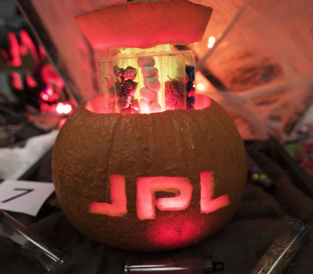 An entry in JPL's 2016 pumpkin-carving contest. A sign accompanying this candy-filled pumpkin read: