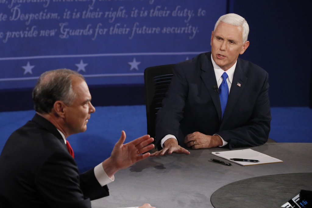 Democratic candidate for Vice President Tim Kaine (L) speaks as Republican candidate for Vice President Mike Pence looks on during the first vice presidential debate at Longwood University in Farmville, Virginia on October 4, 2016. Hillary Clinton and Donald Trump's running mates carry the race for the White House Tuesday, in their only debate of the campaign with the US elections five weeks away. / AFP / POOL / ANDREW GOMBERT        (Photo credit should read ANDREW GOMBERT/AFP/Getty Images)