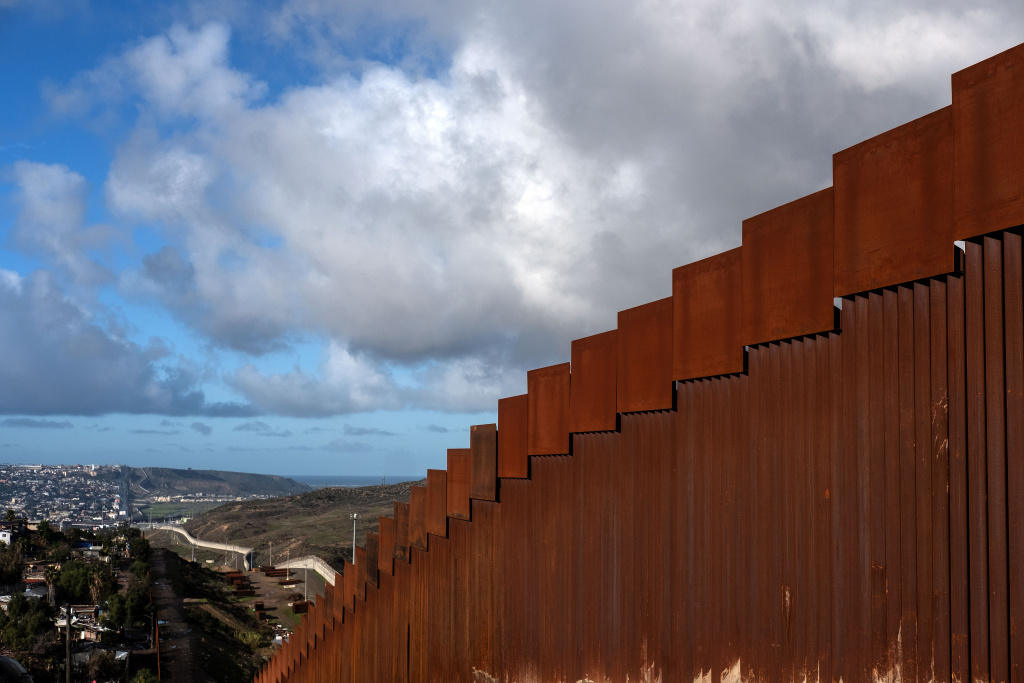 A section of the reinforced US - Mexico border fence on the Otay Mesa area, San Diego County, as seen from Tijuana, in Baja California state, Mexico, on January 6, 2019.