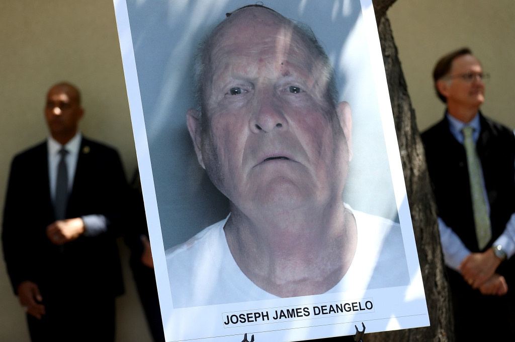A photo of accused rapist and killer Joseph James DeAngelo is displayed during a news conference on April 25, 2018 in Sacramento, California.