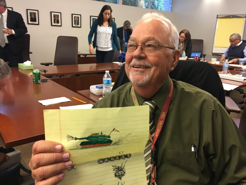 L.A. Unified School Board member Richard Vladovic holds up a doodle of a tank he drew during Tuesday's meeting. He drew it out of frustration during a discussion session about the board's vision, which he found repetitive.
