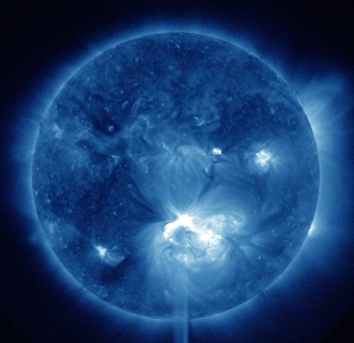 This false-color image provided by NASA shows a solar flare, lower center, erupting from the sun on Thursday, July 12, 2012.