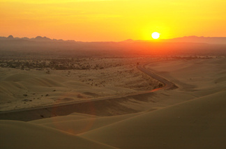 The sun rises over the Algodones Dunes, also known as the Imperial Dunes or American Sahara, on July 20, 2003 near Glamis, California in the Colorado Desert between Brawley, California and Yuma, Arizona.