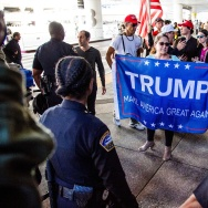 Trump supporters lead a counter-protest of the executive order by US President Donald Trump, banning immigrants from seven majority-Muslim countries at Los Angeles International Airport.
