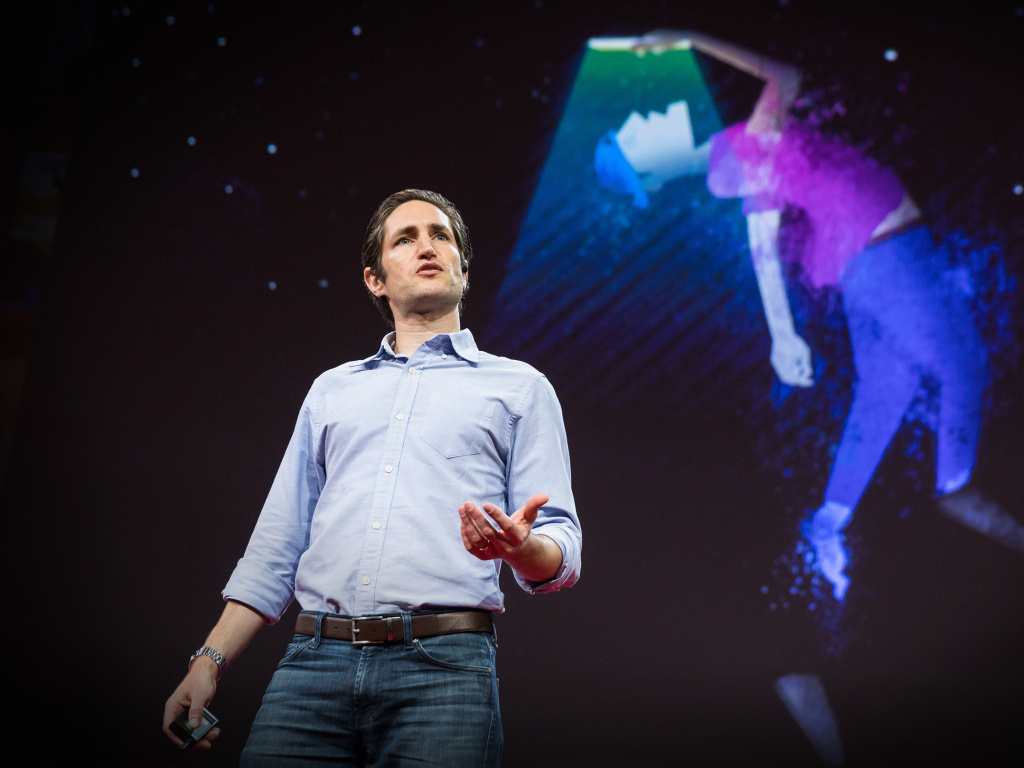 Adam Alter on the TED stage.