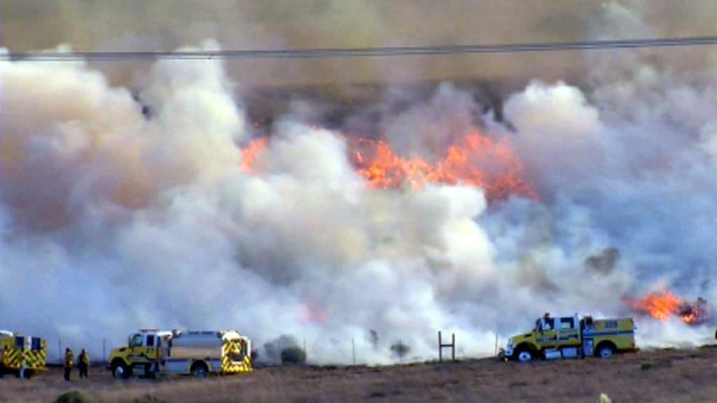 Firefighters battle the Grand Fire in Kern County.