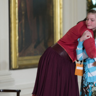 First lady Michelle Obama hugs Charlotte Bell, 10, after the girl handed the first lady her dad's resume on Thursday.