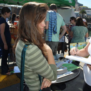 Shopper signs petition at farmer's market