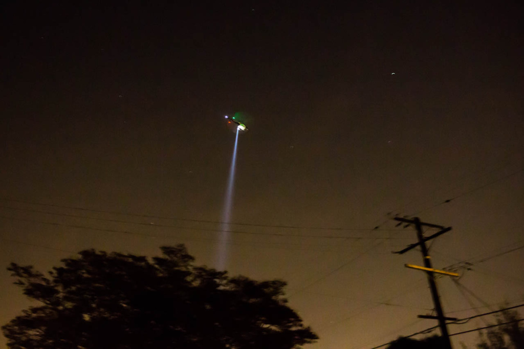 A Los Angeles Police Department Helicopter hovers over Highland Park in northeast Los Angeles on April 13, 2013.