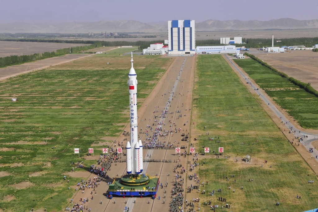 The Shenzhou X spacecraft carried by a Long March-2F carrier rocket is installed at the launch pad in Jiuquan, Northwest China's Gansu province in the morning of June 3, 2013. The spacecraft will carry three astronauts to visit the Tiangong-1 space module.
