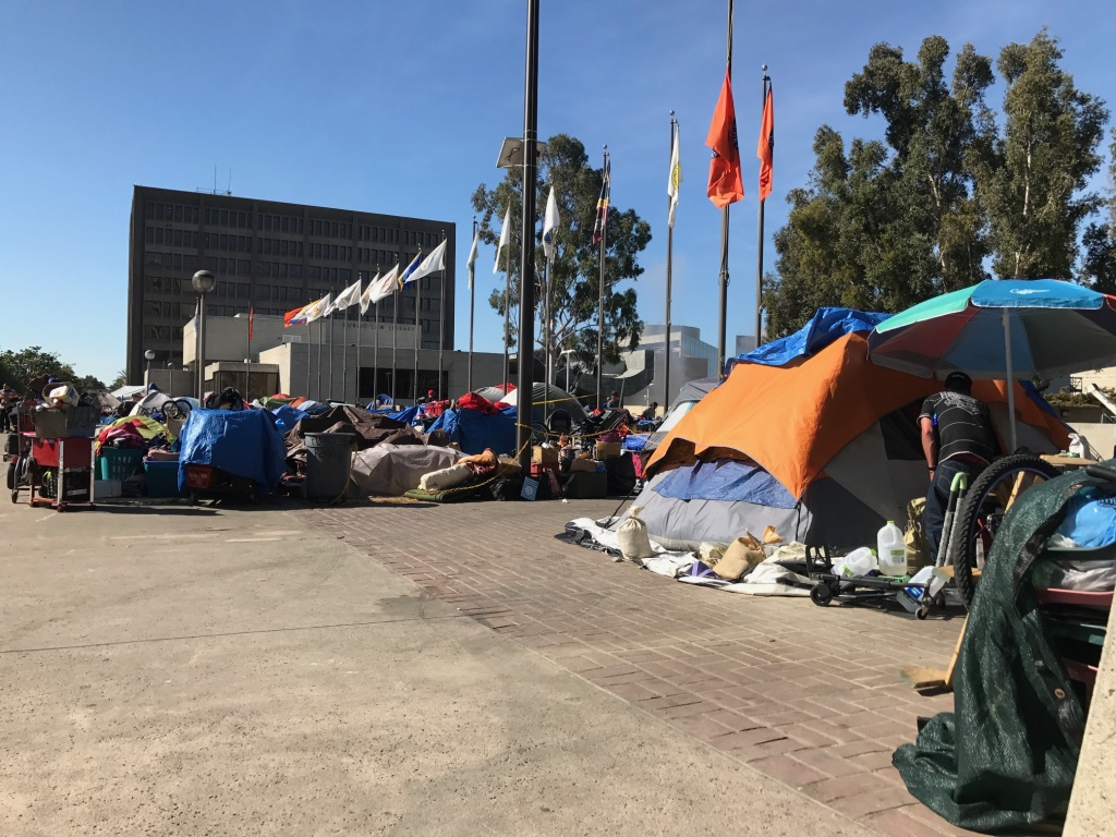 Homeless tents in the Santa Ana Civic Center's Plaza of the Flags in mid-2017. Under new regulations enacted by the city of Santa Ana in late 2017, tents are supposed to be taken down in the daytime and the plaza is periodically power-washed.