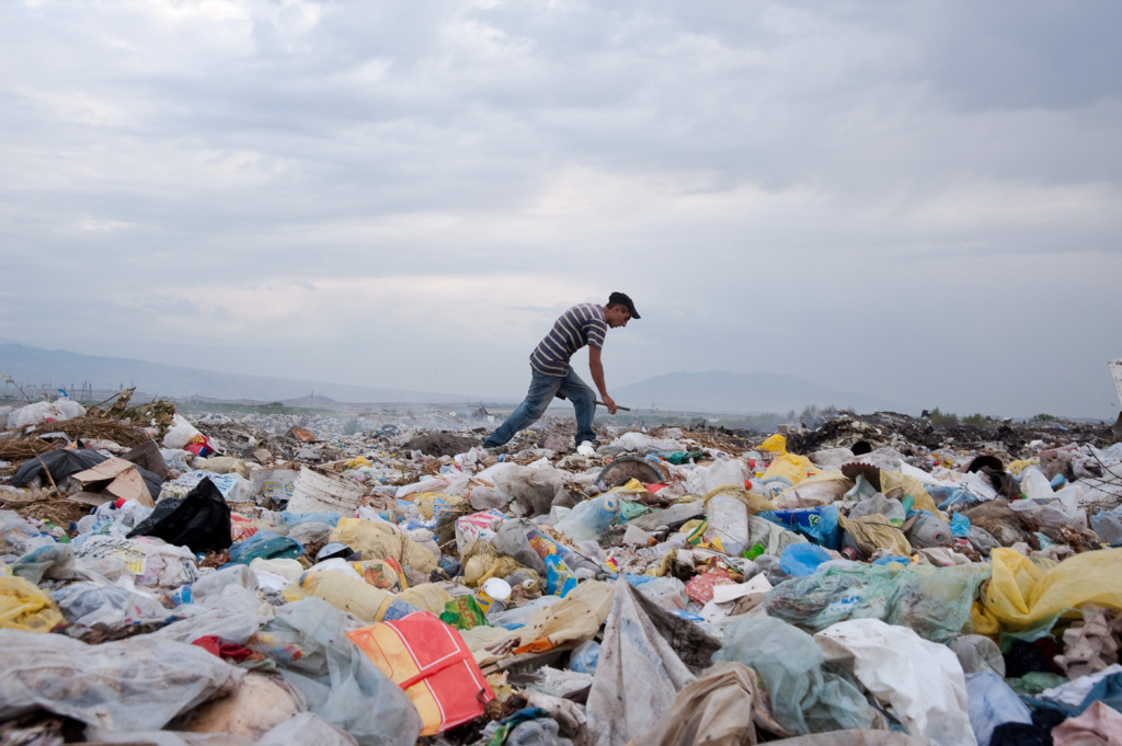 Grigor, 29, rummages through a garbage dump in search of metals, plastics, and glass to sell and shoes to burn for fuel. Grigor lives with his wife, three young children, and mother in a shack within walking distance from the garbage dump.