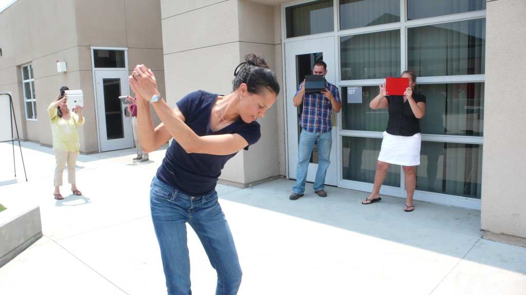 Coachella Valley Unified teachers record as Judith Capper demonstrates a golf swing.