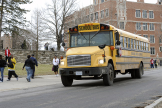 Students prepare to leave on a school bus from Westport High School on March 11, 2010 in Kansas City, Missouri. The High School is among 29 in a district of 61 schools that will close due to the new budget plan that is making the cuts to ward off bankruptcy.