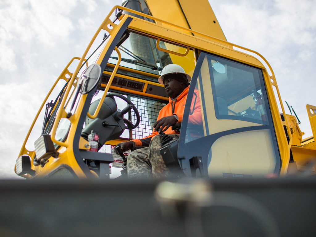 In this file photo, former student Nathaniel Simmons operates a crane during a day of training at Georgia College of Construction. In September, construction companies added 8,000 jobs. But the tepid jobs report from the government on Friday, October 2, 2015, suggested that the U.S. economy, which has been outshining most others around the world, is weakening.