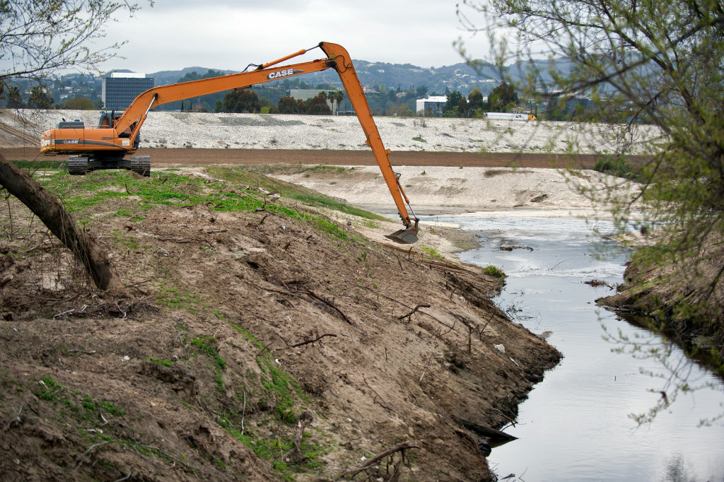 An excavator packs soil at the Sepulveda Dam to prevent from turbid water on Feb. 19. The Sepulveda Dam is a project of the U.S. Army Corps of Engineers, built in 1941 to withhold winter flood waters along the Los Angeles River.
