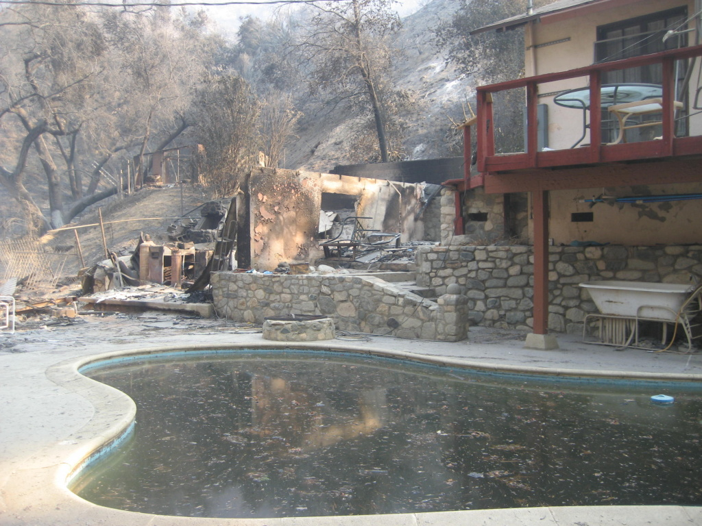 Ash in the pool of a home damaged by the Station Fire in Big Tujunga Canyon.
