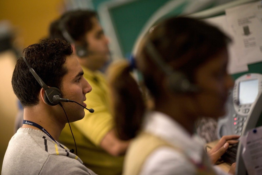 Indian operators take calls at Quatrro call-centre in Gurgaon on the outskirts of New Delhi on December 5, 2008.