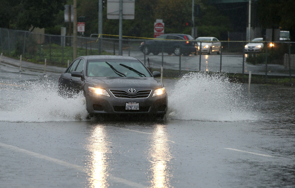 File: A car drives through standing water on December 11, 2014 in San Francisco, California.
