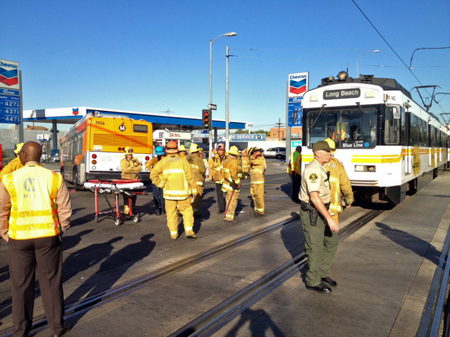 The scene following a crash between a Metro bus and Blue Line train Monday morning, Aug. 27 at San Pedro Street and Washington Boulevard.