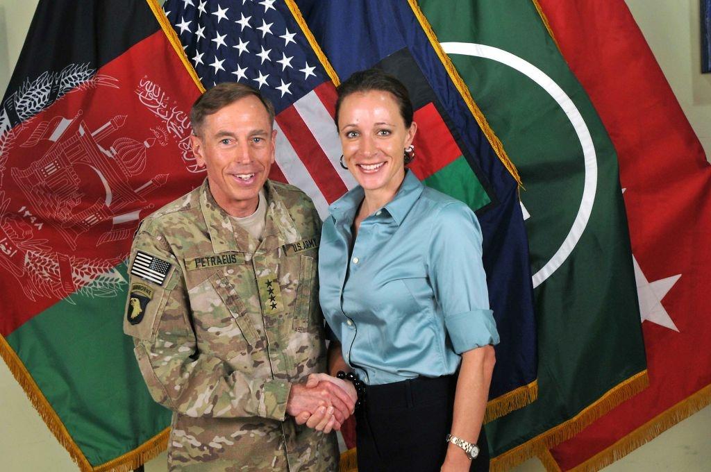 Former CIA Director Gen. Davis Petraeus (L) shakes hands with biographer Paula Broadwell, whom he had an extramarital affair with.