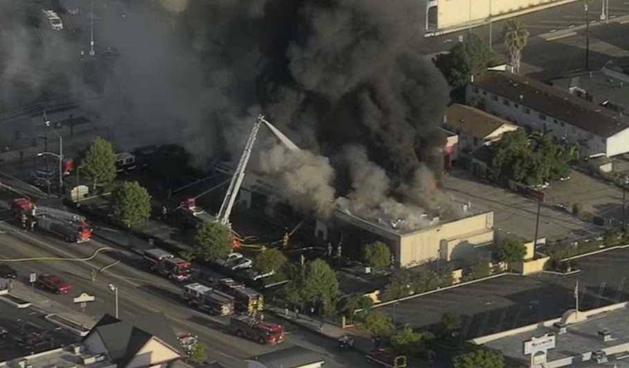 Aerial footage from NBC Los Angeles shows firefighters battling a massive blaze at a San Gabriel strip mall on Wednesday, May 16, 2018.