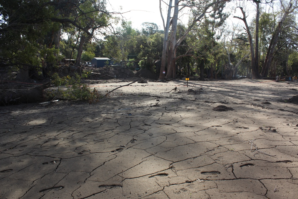 Dried mud covers the ground in an area of Montecito on Thurs., March 8, 2018 that was devastated by a mudslide two months earlier.