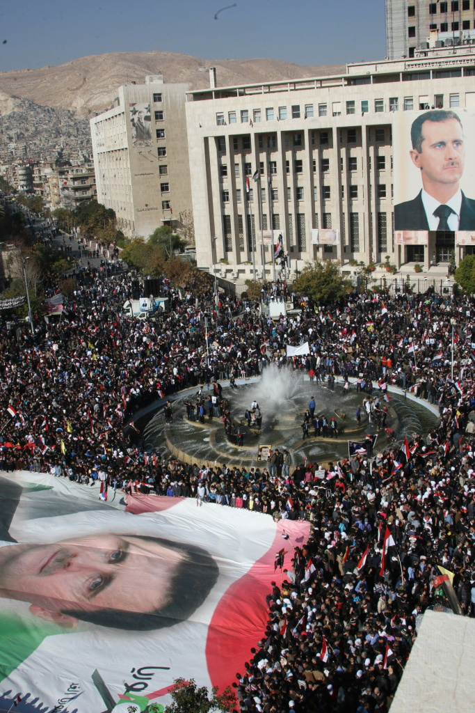 A giant portrait of embattled Syrian President Bashar al-Assad is carried in a sea of thousands of Syrian demonstrators in the capital Damascus on November 28, 2011. Protesters waved Syrian flags and chanted nationalist songs in a demonstration against the Arab League decision to impose crippling sanctions on President Bashar al-Assad's regime. Syria has also come under sharp criticism from an independent commission that accused the security forces of systematically carrying out abuses against anti-government demonstrators.