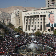 A giant portrait of embattled Syrian Pre