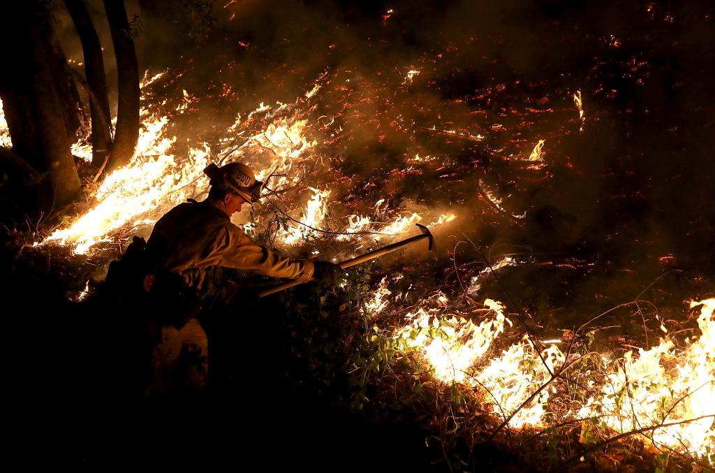 A CalFire firefighter battles the Tubbs Fire on October 12, 2017 near Calistoga, California.