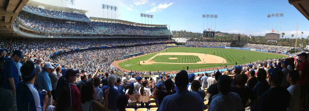 A panorama of Dodger Stadium taken during a seventh inning stretch.