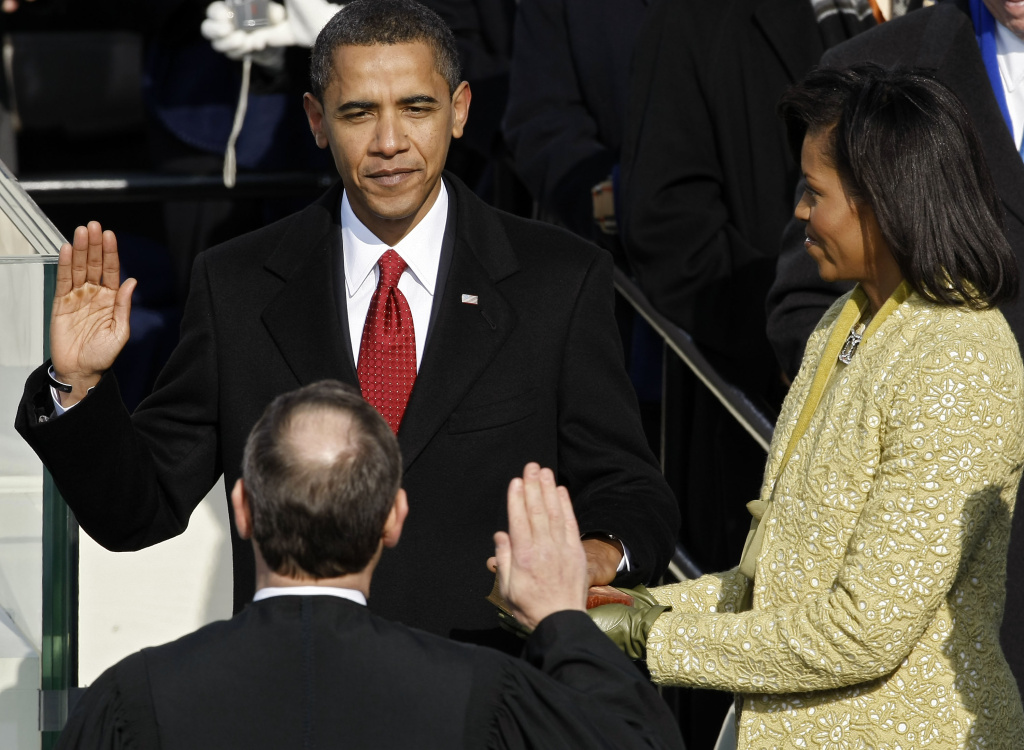 Barack H. Obama is sworn in by Chief Justice John Roberts as the 44th president of the United States as his wife Michelle looks on January 20, 2009 in Washington, DC. Obama becomes the first African-American to be elected to the office of President in the history of the United States.