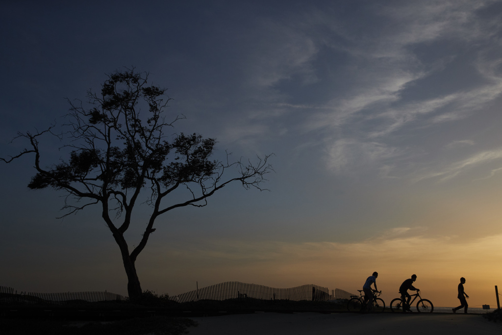 In this Thursday, April 12, 2018 photo, three boys stroll along the beach in Carpinteria. The town, about 85 miles northwest of Los Angeles, is located on the bottom of Santa Barbara County, a tourist area famous for its beaches, wine and temperate climate. It's also gaining notoriety as a haven for cannabis growers.