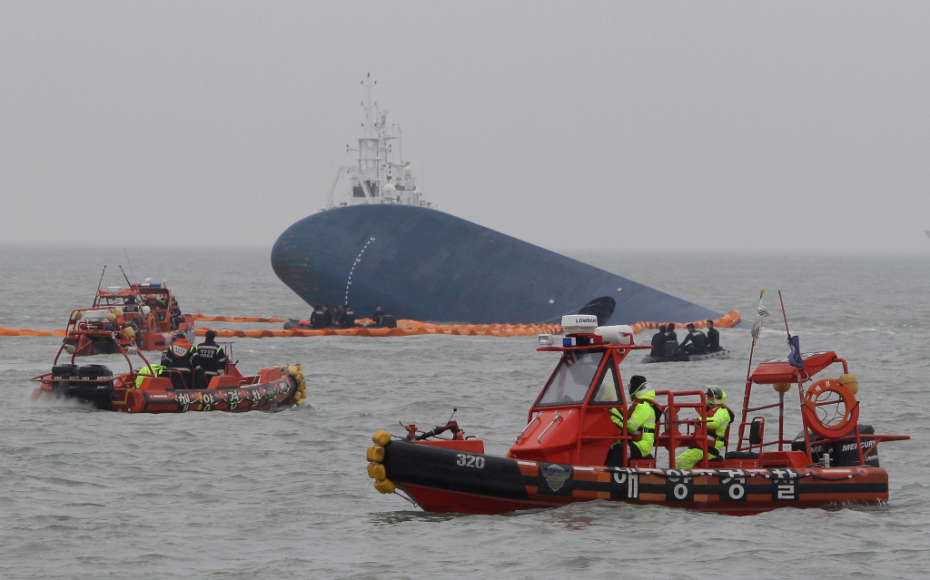 South Korean Coast Guard and rescue teams search for missing passengers at the site of the sunken ferry off the coast of Jindo Island on April 17, 2014 in Jindo-gun, South Korea. At least six people are reported dead, with 290 still missing. The ferry identified as the Sewol was carrying about 470 passengers, including students and teachers, traveling to Jeju Island.  (Photo by Chung Sung-Jun/Getty Images)