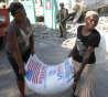 The IOM - International Organization for Migration distributes food to the quake victims on March 24 2010 in Port-au-Prince, Haiti