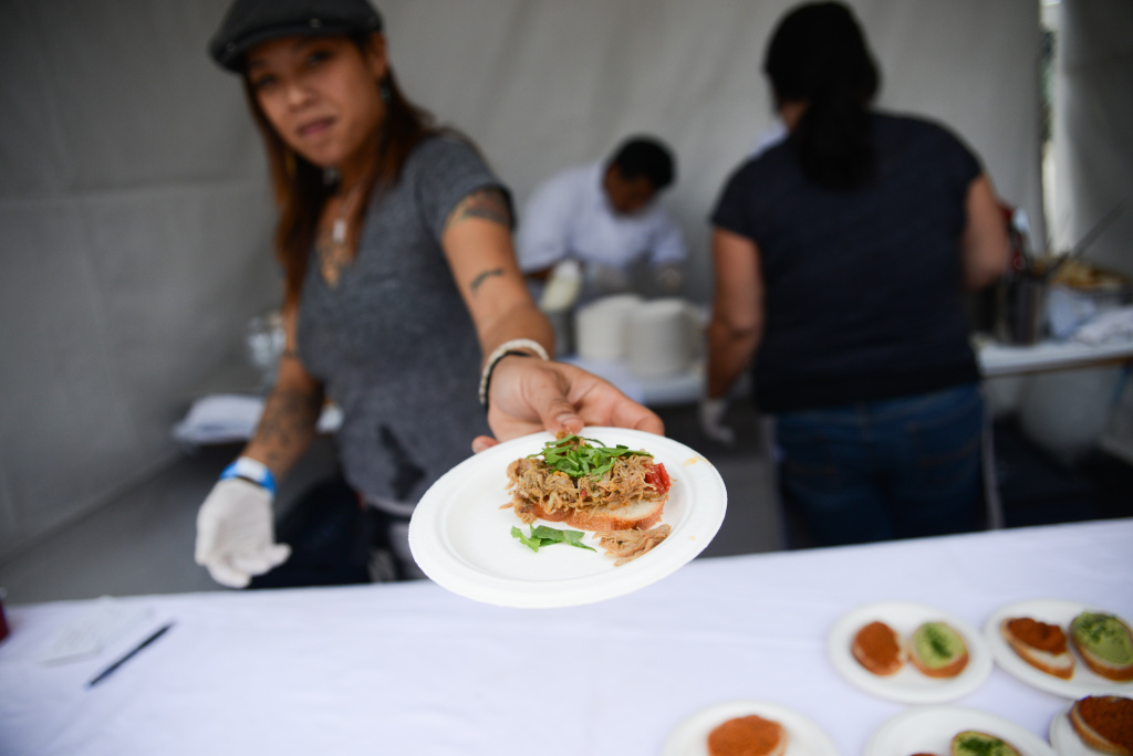 A participant in the 2017 Taste of the Nation food festival.