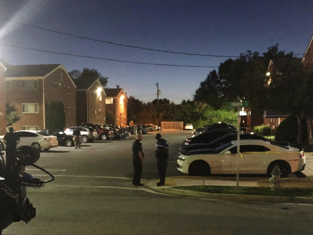 Police block off the area around the home of a suspect who opened fire on a newspaper office in Maryland's capital earlier, in Laurel, Md., on Thursday. A law enforcement official said the suspect has been identified as Jarrod W. Ramos.