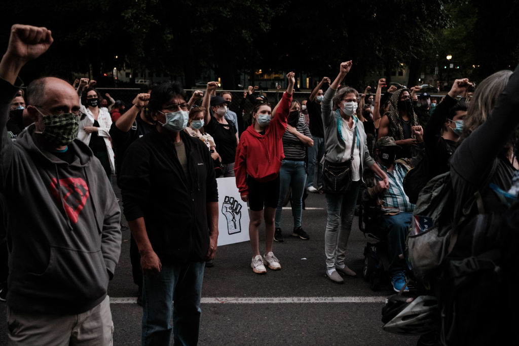 Protestors raise their hands up in solidarity after Portland Commissioner Jo Ann Hardesty speaks to the crowd Portlanders' rights to free speech and assembly at Multnomah County Justice Center on July 17, 2020 in Portland, Oregon.