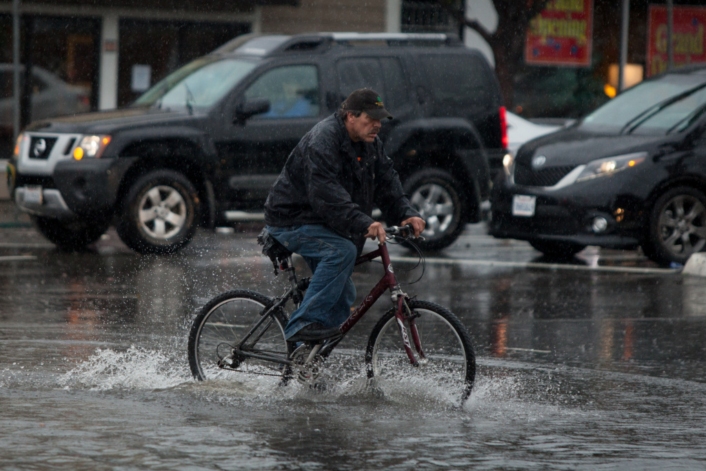 FILE: It's possible to go bike riding safely in the rains, if you're prepared for it, experts advise.