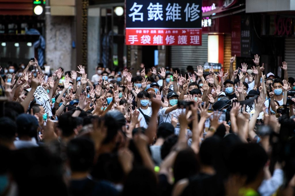 Protesters chant slogans and gesture during a rally against a new national security law in Hong Kong on July 1, 2020, on the 23rd anniversary of the city's handover from Britain to China.