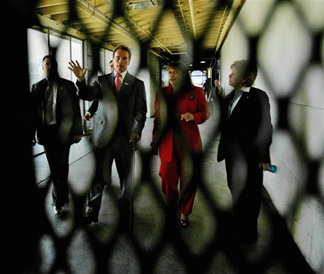 California Gov Arnold Schwarzenegger, second from left, tours a prison with officials, Tuesday, March 6, 2007, in Norco, Calif.