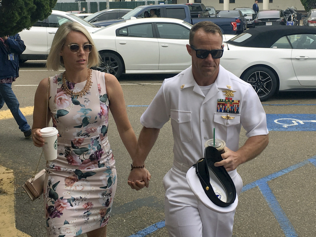 Navy Special Operations Chief Edward Gallagher and his wife, Andrea Gallagher, arrive at military court on Naval Base San Diego on Thursday. A witness stunned prosecutors after testifying that he, not Gallagher, killed an ISIS fighter in 2017.