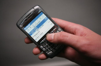 The social networking site Facebook is displayed on a Blackberry mobile phone