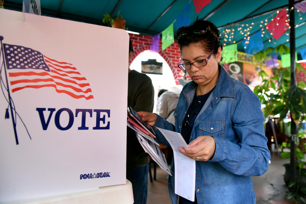 Rosa Ayala checks her ballot after voting in the US presidential primary June 7, 2016 at Sabores de Oaxaca, a Mexican restaurant in Los Angeles, California.